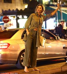 Gisele Bündchen flashed her toned midriff as she hailed a cab barefoot during a Chanel photoshoot in Paris