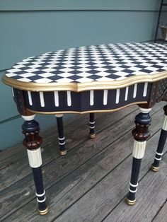One of my first tables painted in a whimsical black and white check style. See more like this item in my Etsy shop, EddiesGarden.