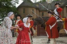 "Revolutionary City Book: ""The Town is Taken"" scene at the Capitol. Benedict Arnold speaking to townspeople with a guard of Redcoats. Photo by David M. Doody."
