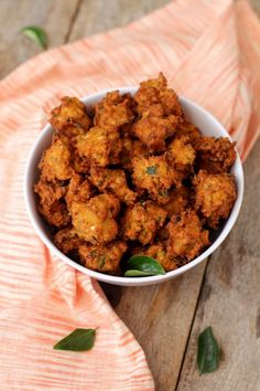 Corn Pakoda recipe is an easy to make snack using sweet corn. You can serve corn pakora as a starter too. Learn how to make snacks with sweet corn for kids.