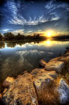 scenic photo of a clean lake, with bright sunshine and the amazing formation of the clouds in the sky