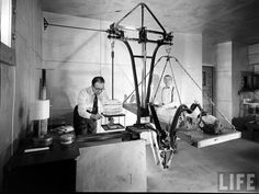 Taken in the late 1940s - early 1950s in the Worcester State Hospital for the Criminally Insane in Massachusetts. Prior to the de-institutionalization movement in the late 1970s, the treatment for psychosis consisted of artificially inducing a seizure, whereupon this contraption would spin the patient around quickly for a few minutes. Seems like it would more encourage nausea in a patient than rid them of psychosis...