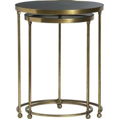 Living room: Moreno Nesting Tables  - I like the brass finish (which is not so brassy in person) to bring out the subtle gold/yellow accents in the rug and pillows.  Versatile tables!