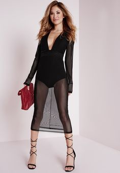 Turn up the temps in this one this weekend. This killer little black dress is exactly what you need for this party season. With deep plunge neck line, long sleeves and bodysuit underlay this mesh midi is flawless. In figure flattering black...