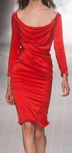 Oh, the Brightness of Orange. I love it. On a  very cool style of a dress. The cowl neckline, and the looser fitted tucks in rows. To the knees in length is fantastic. Well very bright for sure, but the dress looks very Comfortable as it Shines !!!