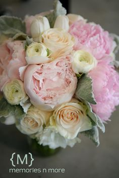ivory, peach and light pink, ranunculus, peony, rose, tulip and dusty miller bouquet