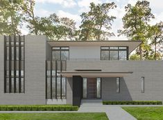A courtyard house for an active family currently under construction in Piney Point (within Houston, Texas) in a large wooded site.