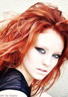 Lovely, vibrant red teased hair
