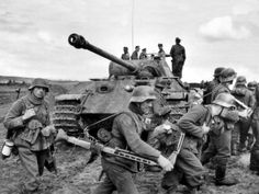 """A German Panther tank lead by SS-Standartenführer Johannes Mühlenkamp, commandant of the SS-Panzer-Regiment and troops from the 5th SS-Pz Div """"Wiking' grenadiers, 131st Infantry Division. Ukraine, Kovel. 1944."""