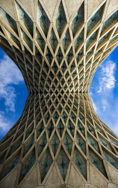 Symmetry: The Azadi tower in Tehran, IRAN is an example of reflective symmetry.  If you draw a central axis, there is a mirrored image above and beyond.  Symmetrical properties tend to be more eye catching and better remembered.  This example shows balance and harmony in this design.