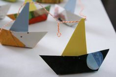 Paper boat garland from children's book pages / yellow, blue, orange