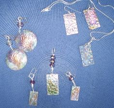 Copper inked earrings and pendants.