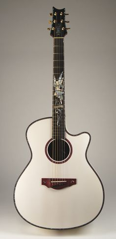 What a beautiful guitar. I couldn't help myself to create a new board for this - white gabriel concert guitar.