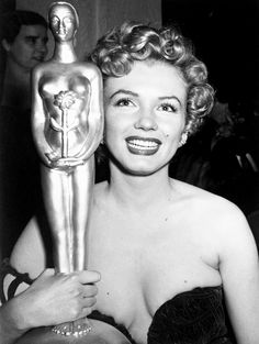 """"""" Marilyn Monroe holds her Henrietta Award for Best Young Box Office Personality in 1952. """""""
