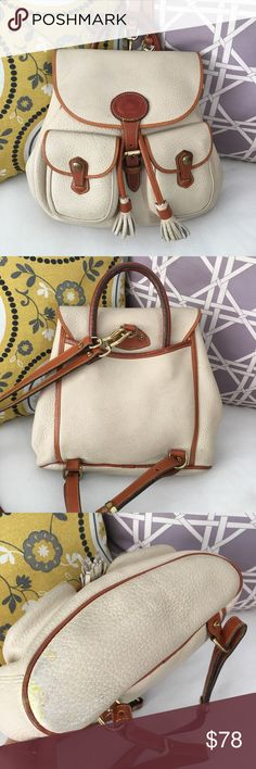 "Vtg Dooney Bourke AWL Bone Drawstring Backpack Vintage Auth Dooney & Bourke all weather leather (AWL) drawstring backpack in bone (ivory/off-white) with tan leather trim. Great for everyday! Overall in good condition. Leather trim and hardware show wear and marks, several areas of marks, dirt and discoloration throughout. One bottom corner has a notable stain. Generally clean inside, some pen marks on the inside flap and top of the inside pocket. Measurements: 10.5""W x 10""Hx 3.5""D. Shoulder…"