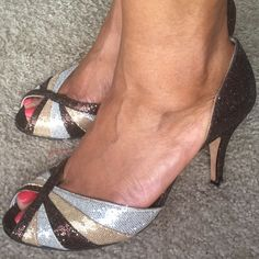Nina Fabulous 3 Inch, Colorful Heels I love these heels. They are elegant and colorful. This pair is a size 8 1/2. Nina is an excellent brand known for its classy shoes. These shoes are a shimmery brown, silver, and gold. They were worn one to church. They don't look worn at all except on the soles, which is very light. The possibilities are endless. Thanks for browsing!  Nina Shoes Heels