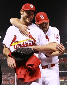 St. Louis Cardinals starting pitcher Michael Wacha is embraced by teammate Jake Westbrook after coming one out away from pitching a no-hitte...