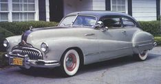 1947 Buick Roadmaster fastback 2-door coupe, fender skirts, the famous bomb site ornament. Straight-8. And fast.