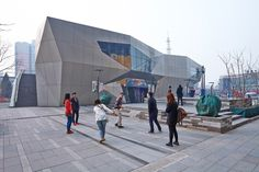Built by 6A2 Studio, Architectural Design & Research Institute of Tsinghua University in Beijing, China with date 2012. Images by Archexist. West Street No.1 is a mini complex of tenant's flagship store, which is located in Wudaokou, one of the most famous c...