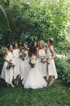 We love an all white bridal party for a spring or summer wedding! Opt for simple styles for your 'maids so you shine bright on the big day. - BHLDN Stylists | image via: theLANE