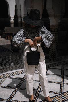 Fashion blogger Beatrice Gutu creative direction styling gingham top trend with Simon Miller bonsai bag in Marrakech La Mamounia