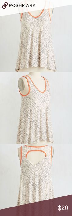 "New ModCloth Chevron the Move Top New without tag ModCloth Chevron the Move Top. When you need a casual look for a coffee date with your best bud, just toss on this breezy top and hit the road! Featuring neon orange trim, a back cutout below a lace insert, and a slight high-low hemline, this ivory and navy, dynamically chevron top is the perfect match for your get up and go attitude! Length 24.5"". Modcloth Tops Tank Tops"