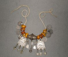 Berber amber necklace. A necklace which includes beads and pendants in silver and fossil Amber. Posted by Alaa Eddine Sagid.