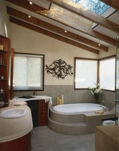 33 Cool Attic Bathroom Design Ideas - An attic can be the perfect space for an extra bath. Exposed beams and skylights can make this bathroom a cool and relaxing retreat. Check out all these pictures and you'll also see that the bathroom is the great way to make great use of the top floor.