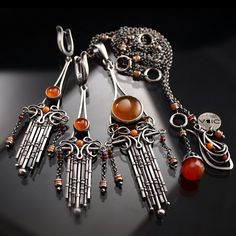 hand made jewelry set necklace and earrings technique: wire-wrapping materials: sterling silver, carnelian, coral by Bartosz Ciba AVAILABLE here: www.bartoszciba.com/pl/search?…
