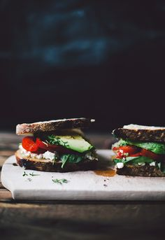 toasted sourdough bread, cottage cheese, tomato, watercress, spinach, avocado & olive oil