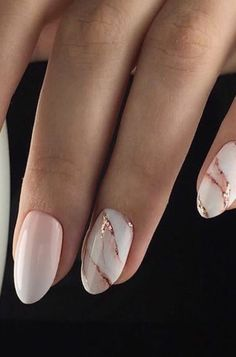 Marble rose gold almond shaped nails.