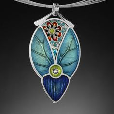Ivy Woodrose jewelry.  Sterling and resin.  Lovely detailed work.