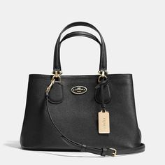 Soft lines meet streamlined construction on a modern yet feminine mini carryall crafted in durable Crossgrain Leather. Designed for the woman on the go, its refined silhouette is finished with distinctive T-bar hardware and a detachable crossbody strap.