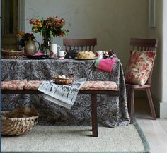 Bench, Lombok. Dining chairs, Heal's. Tablecloth: Harvest Hare, St Jude. Cushions, Mini Bouquet/Bouquet, Elanbach.