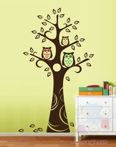 Brown, red, and green owls in tree!!! COOL;~)