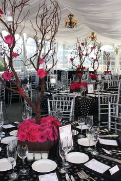 Pink gerbera daisy paired with black and white wedding table setting. Very pretty!