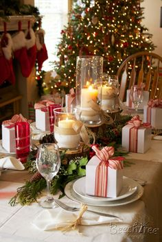 """Christmas Table Ideas: Decorating with Red and Green - All natural materials help create this """"woodland"""" themed table setting. I love the packages at each place setting."""