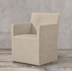 RH's Ellison Track Arm Fabric Armchair:With restrained lines and slim proportions, our collection exudes timeless simplicity. Amply cushioned for comfort, each chair appears to float on its recessed base.