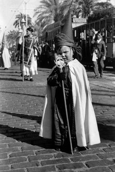 Seville, Spain. A young participant to the Holy Week procession. By Robert Capa, (April 1935)