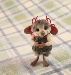 Miniature handmade mouse. This level of cuteness is just too much. Love it. Xxx