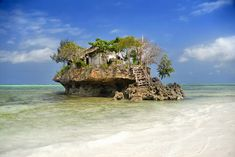 The Rock Restaurant in Zanzibar, Tanzania. Just a restaurant on a rock. On the beach. How cool would it be to eat here?