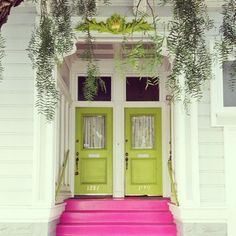 Great porch! Bright pink steps leading to bright green doors