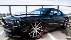Dodge Challenger SRT8... Not a fan of the rims, I like the old school muscle car rim style.