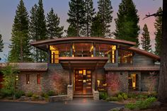 This contemporary mountain home utilizes floor to ceiling windows, massive lift-slide doors, and soaring curved roofs to bring the outdoors in and capture the beauty of the mountain surroundings. The home is finished with natural materials of stone, steel, copper, cedar and mahogany for beauty, longevity, and low maintenance. The home centers around the Kitchen and features a getaway Media/Apre Ski Room, a Yoga Loft, Steam Room, and a spectacular Master Suite. This project is the…