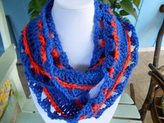 This scarf is 4 1/2 inches wide by 33 inches long and is made with acrylic yarn. Strong recommend hand wash and drape to dry.