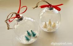 A simple way to make DIY Snow Globe Ornaments with craft trees to make a mini winter forest.