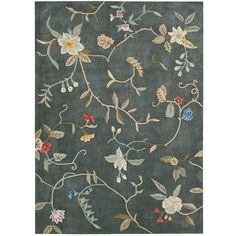 This beautiful hand-tufted area rug features a rich blue, red, yellow, grey, green and ivory color palette. Exquisite detail carved deeply into the dense, cut-and-loop pile for a dramatic texture and bold contrast in this rug.