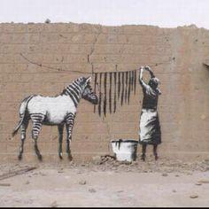 street art.  Zebra doing laundry. 000
