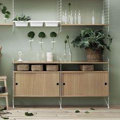 Dressoir wit/eik - Livingdesign https://www.livingdesign.be/nl/merken/string