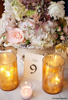 This vintage flower pot accented with vintage candle holders makes a beautiful wedding reception table centerpiece!